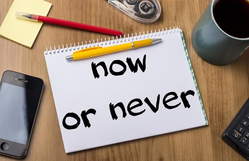now or never - Note Pad With Text On Wooden Table